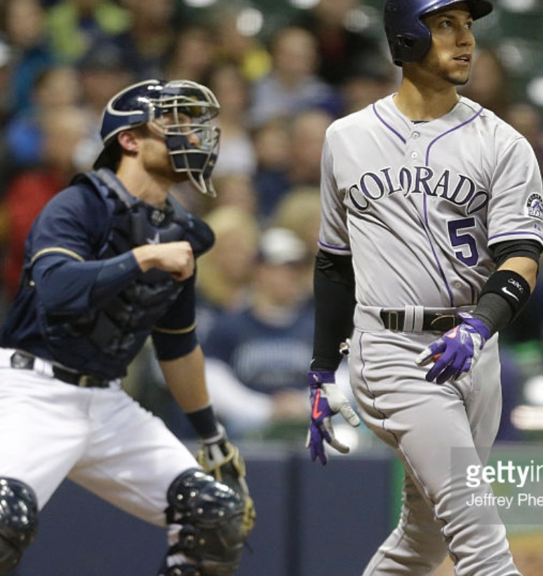 In+an+image+characteristic+of+the+Brewers%27+start+to+the+season%2C+Carlos+Gonzalez%2C+Rockies+outfielder%2C+looks+at+his+home+run+in+the+eighth+inning+of+Wednesday%27s+game+at+Miller+Park+as+Jonathan+Lucroy%2C+Brewers+catcher%2C+can+merely+gander+at+the+shot.+The+Rockies+would+win+the+game+5-4+in+10+innings.+Photo+provided+by+Getty+Images