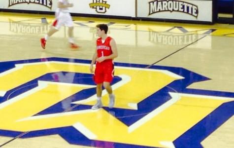 Marotta drives past defenders en route to Marquette