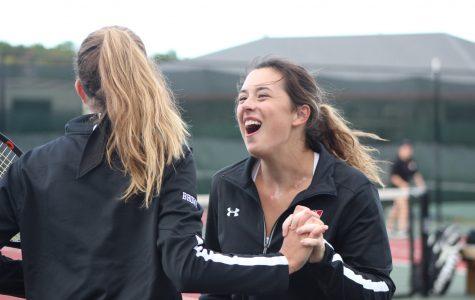 Girls varsity tennis team wins conference tournament