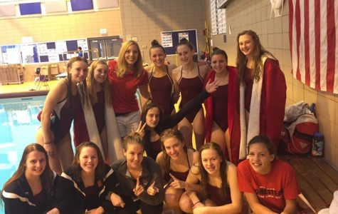 Girls varsity swim and dive team competes at conference