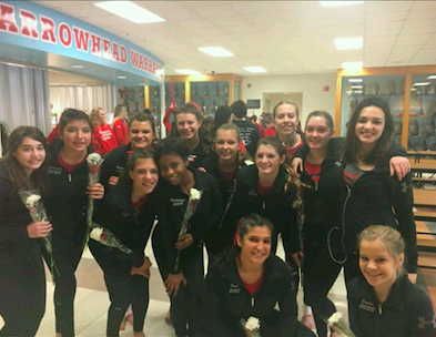 Gymnasts pose for a picture after the Arrowhead Invite.