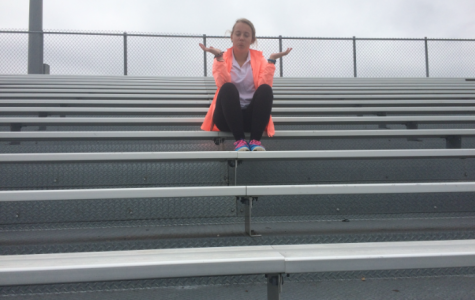 Sam James, junior and avid football fan, looks around the empty stands wishing there for a game this Friday night.