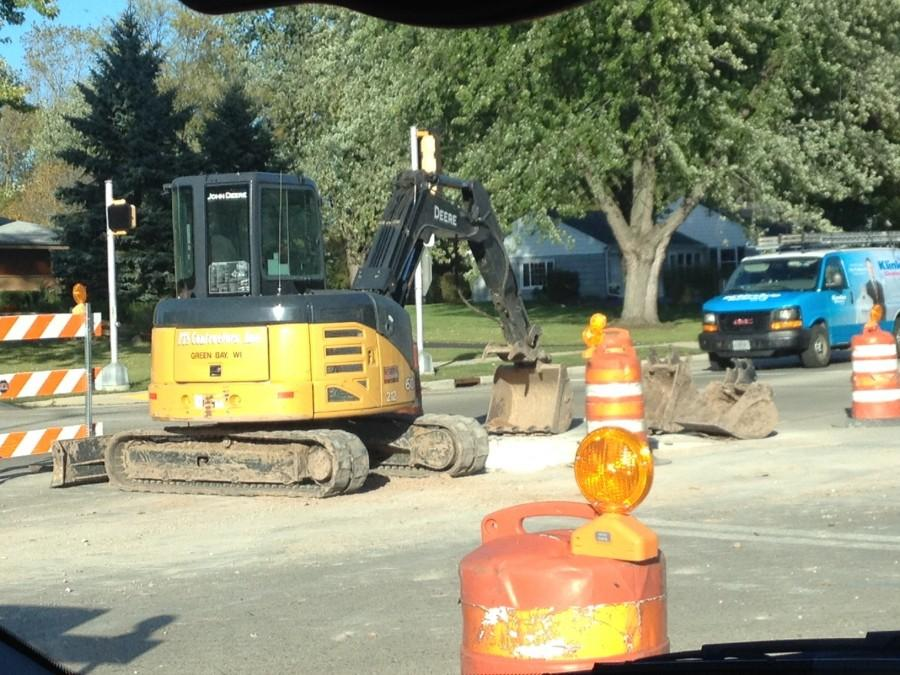 Road workers work on the sanitary lift station at the intersection of River Road and Mequon Road during the week of Oct. 6, 2014.