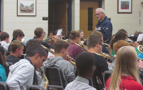 "Mr. Todd Spindler, band director, teaches a combination of Symphonic and Concert band.  The band, in its marching season, has played for the home football games.  ""In marching season you go over the marching outside, like steps,"" Lane Starret, Senior, said of band sectionals."