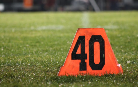 "The forty-yard marker is set up at Milwaukee Lutheran High School for Homestead's varsity  football game on Thursday. Last week, Homestead lost at home against Cedarburg. Michael   Fehrenbach, sophomore, said, ""You get a lot more beat up from games, so you have to take care of your body afterwards."""
