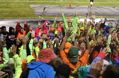 """The Highlander student section goes berzerk for rollercoaster leader, Will Gebhardt, senior. The cheer has been a tradition for many years in the past. """"Homestead's school spirit amazes and makes the whole North Shore envious of them,"""" Carley Bruckner, Nicolet senior, revealed."""