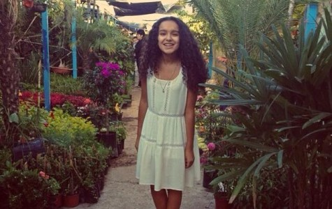 Elisa Carranza, freshman, poses for a photo in an indoor garden. Submitted Photo