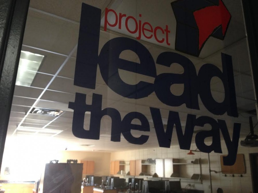 The Project Lead the Way (PLTW) sign stands alone outside the room where the courses would take place. There are no more classes offered in PLTW for the 2014-15 school year, but classes will return for 2015-16 pending a teacher hire and student enrollment.