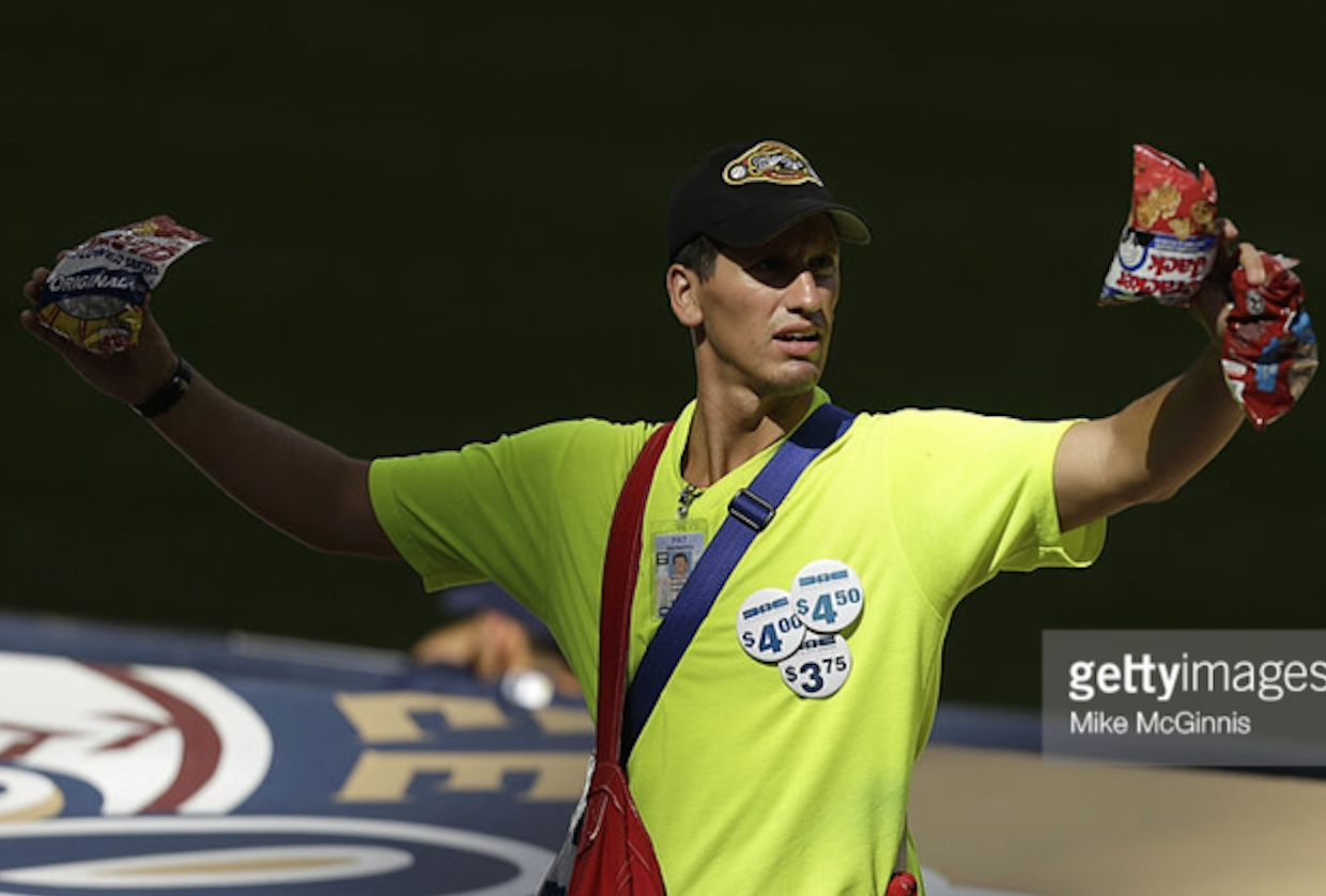 A peanut and Cracker Jack's vendor walks the aisles of Miller Park during a Brewers game last season. Vendors are a critical part of the ballpark's overall entertainment experience. Photo provided by Getty Images
