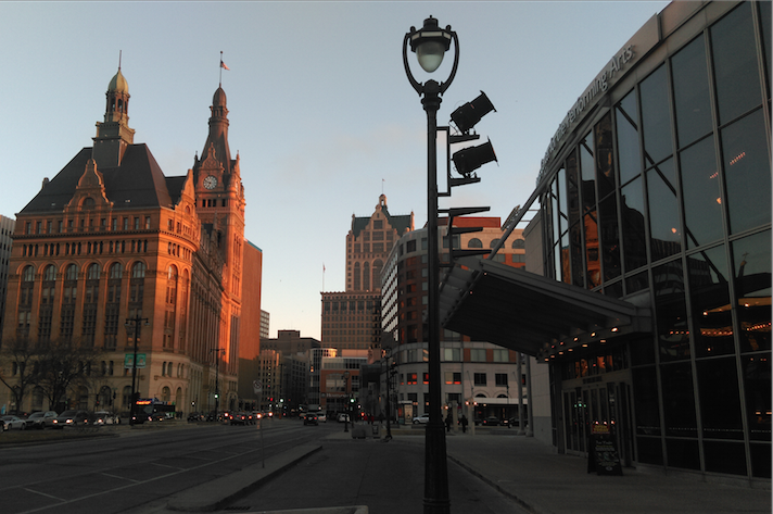 A warm ray of sun illuminates a building downtown on Water Street.