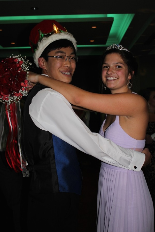 Carolyn Rossman and Eddie Cheng, juniors, dance after their prom coronation.