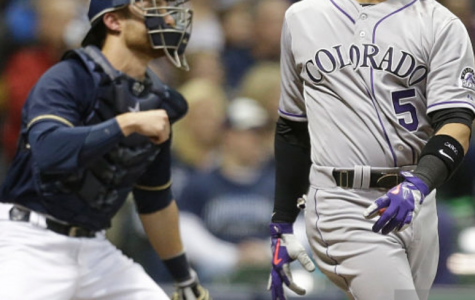 In an image characteristic of the Brewers' start to the season, Carlos Gonzalez, Rockies outfielder, looks at his home run in the eighth inning of Wednesday's game at Miller Park as Jonathan Lucroy, Brewers catcher, can merely gander at the shot. The Rockies would win the game 5-4 in 10 innings. Photo provided by Getty Images