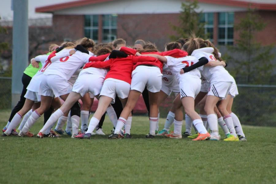 The team huddles up before their game against Wauwatosa East.