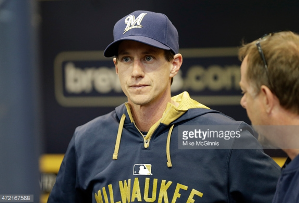 Craig Counsell, the newly appointed manager of the Milwaukee Brewers, stands in the dugout watching his team on Monday night. The Brewers are 2-2 so far in the Counsell era. Photo provided by Getty Images.