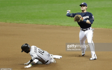 Scooter Gennett, Brewers second baseman, turns the double play as Alexei Ramirez of the Chicago White Sox slides into second base on Wednesday. The White Sox would wing the game, 4-2, and the series, 2-1. Photo provided by Getty Images.