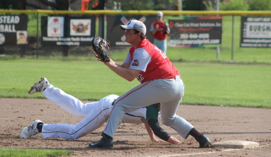 Ryan Cho gets ready to tag a Port runner out at first. The Highlanders won the game with a final score of 5-3.
