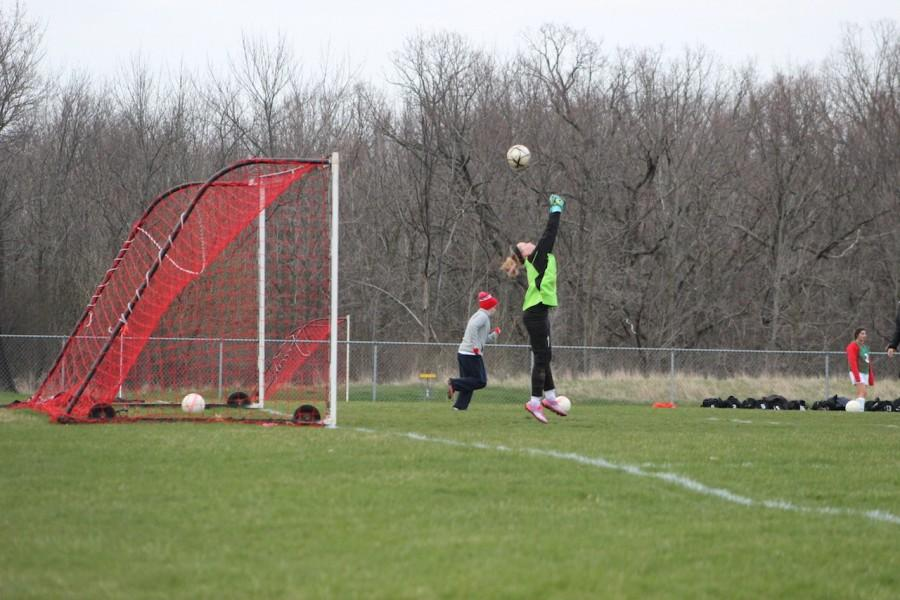 Hannah Malicky, freshman, makes a save during the girls' game against   Cedarburg.