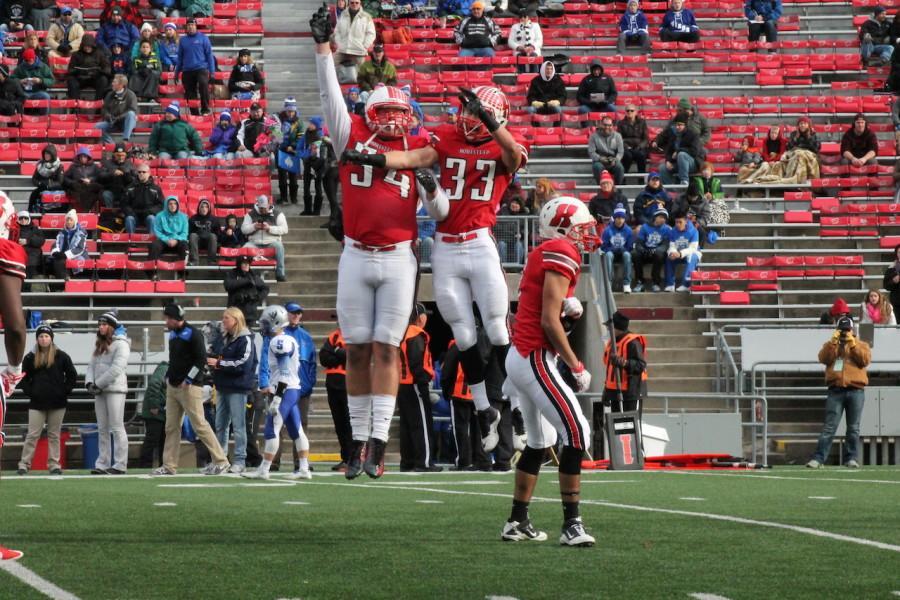 Seniors Josh Mueller and Jake Bruner celebrate before the state championship game.