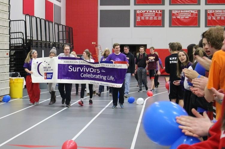 Emma Contardi, junior, and Drew Wagner, sophomore, are just some of the cancer survivors who lead the first lap of Relay for Life 2016.