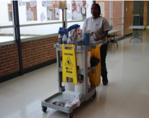 Valarie Johnson, custodian, walks the halls with her cleaning cart.