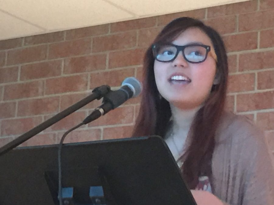 Jenny Lietz, junior, performs a poem at HHS Unplugged. Lietz wrote the poem an hour before the event began.