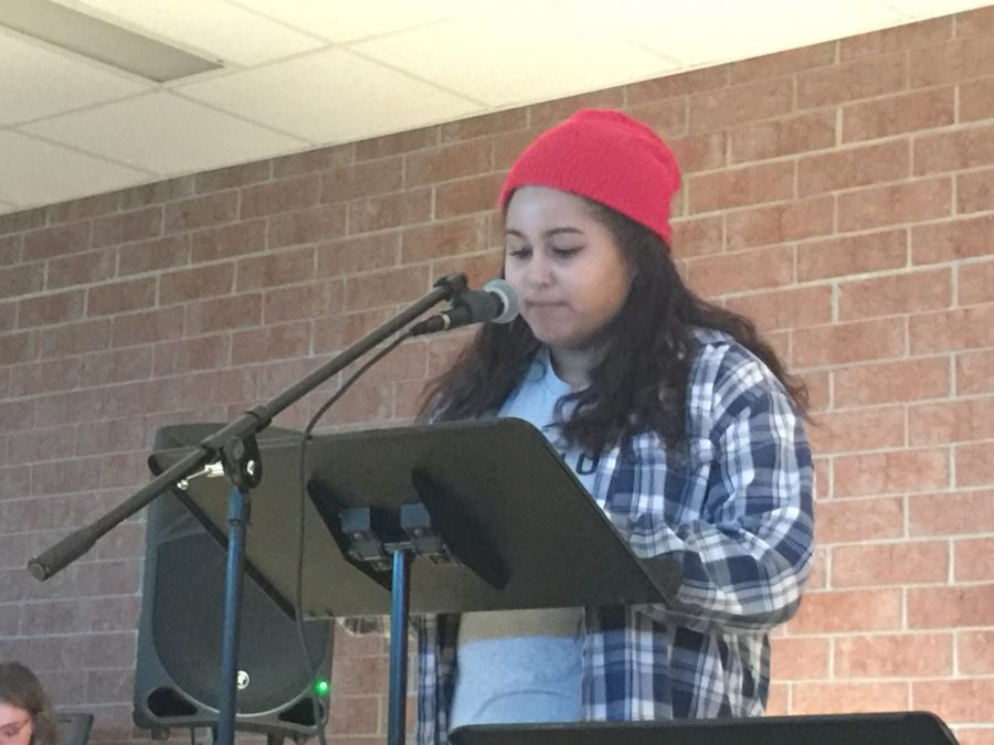 Teighlor McGee, alumni from the Class of 2015 and rising sophomore at St. Catherine University, performs a spoken word at HHS Unplugged. McGee presented this piece at Minnesota SLAM, a poetry competition, and received third place.