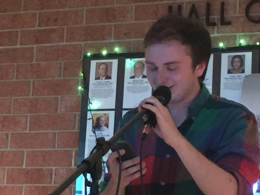 Jesse Honigberg, senior, shares a satirical poem at HHS Unplugged. Honigberg's poem criticized the current generation's overuse of technology.