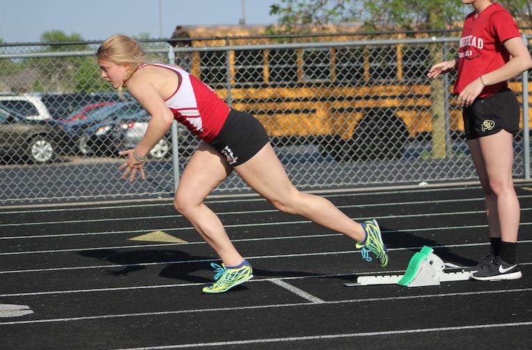 Allison Fochs, senior, comes off the blocks in the 200-meter dash.