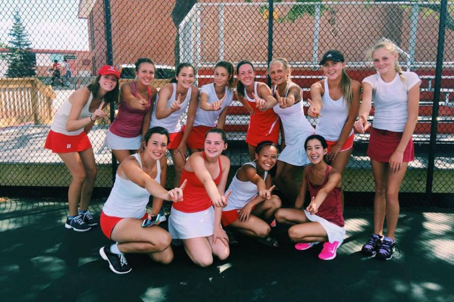 The girls varsity tennis team smiles after a victory. So far, the tennis team has been undefeated and is ranked first in the state. Im looking forward to playing some great matches with my partner and hopefully going undefeated [this weekend,] Bridget Brown, freshman, said.