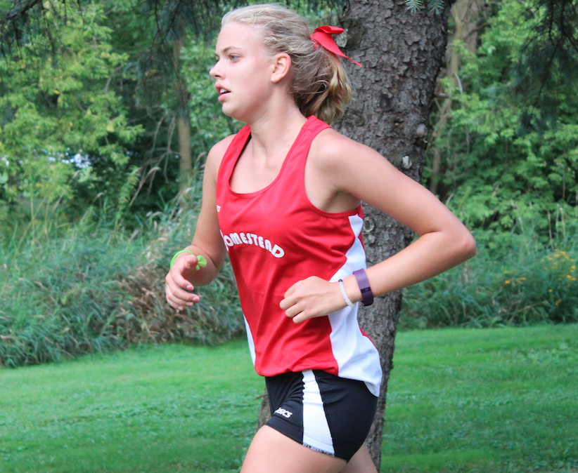 Grace Baden, sophomore, competes at the Menomonee Falls Meet. The Cross Country team has competed in three meets so far and is looking forward to a fresh season.