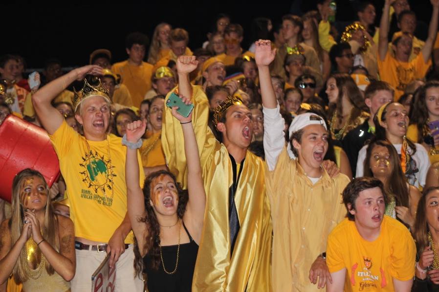 The student section cheers on the football team. The student section decked out in gold to help support childhood cancer awareness.