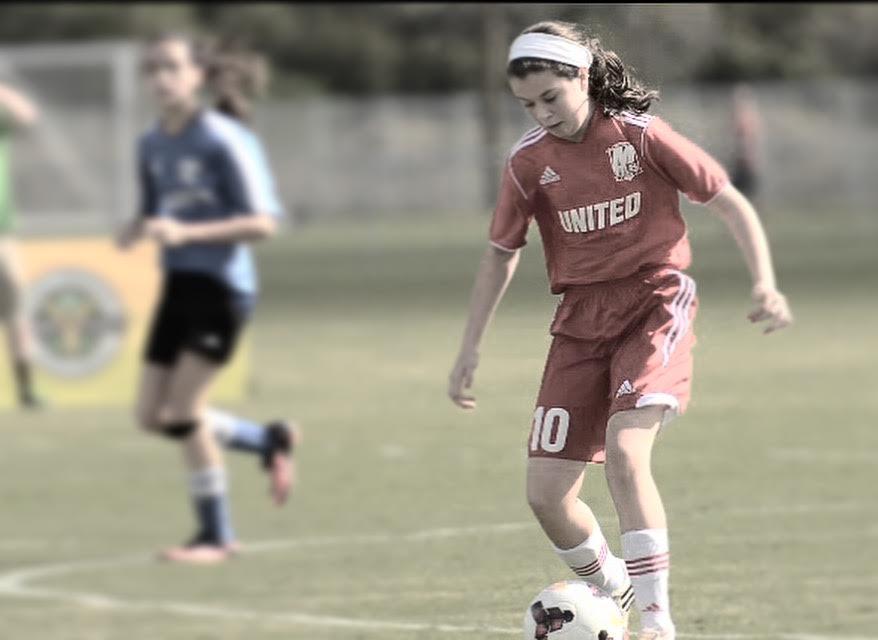 Lindsay kicks the soccer ball during a game.