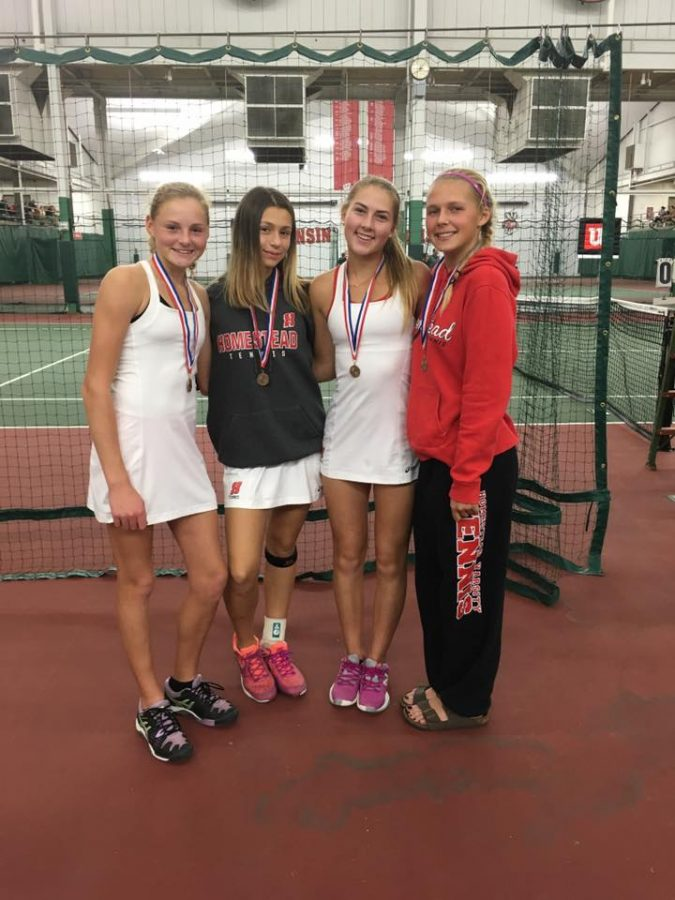 Pictured from left to right: Andie Weise, freshman, Sasha Shapsis, freshman, Frankie LaLonde, junior, Katya Mikhailenko, senior. Four varsity tennis players medaled at state. The individual state tournament was held at the Nielsen Tennis Stadium.