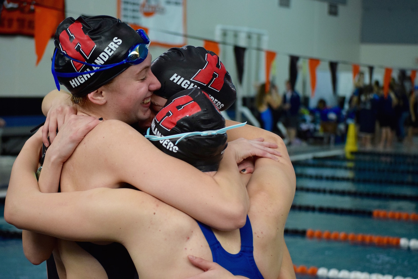 The 400 free relay celebrates after beating the Homestead record.