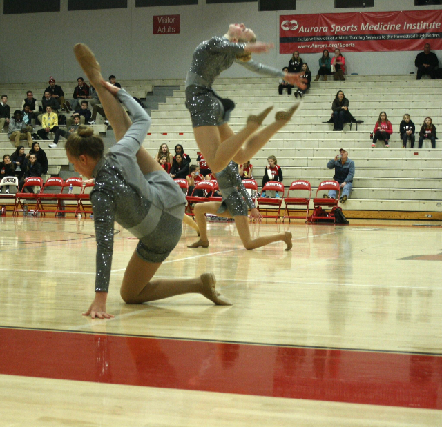 Meer does a solo at half-time at a basketball game.