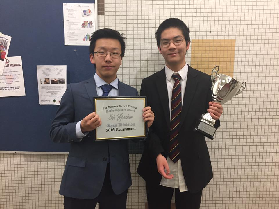 Zidao Wang (left) and his partner Andrew Wang, freshmen, pose with their awards from a debate tournament. 'I love the argumentation that comes with debate,