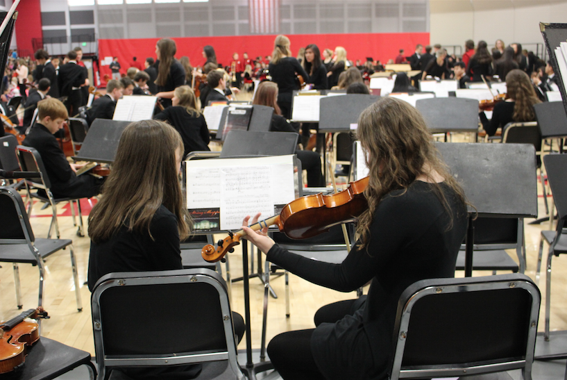Orchestra students rehearse for their performance.