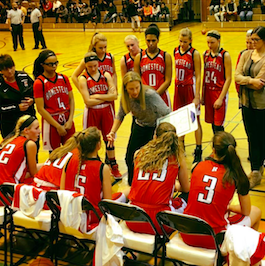 The girls varsity basketball team talks during the game against Whitefish Bay.