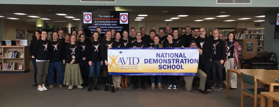 Homestead teachers pose with the National Demonstration School poster minutes after receiving the news of the award. Homestead received the designation on Thursday, Feb. 17, 2017.