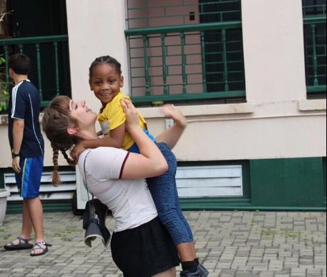 While in Jamaica, Murphy plays with one of the young kids.