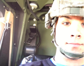 LaBelle sits in a Humvee after running a PM (Performance Maintenance) check.