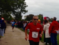 Mr. Sivanich is pictured running a marathon last year.