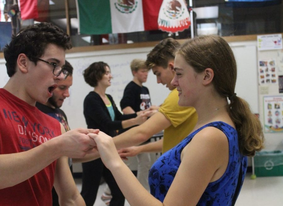 Miranda Grisa and Zach Ginkel, seniors, partner dance the salsa. The salsa is a dance that is mixed with basic steps and saucy turns.