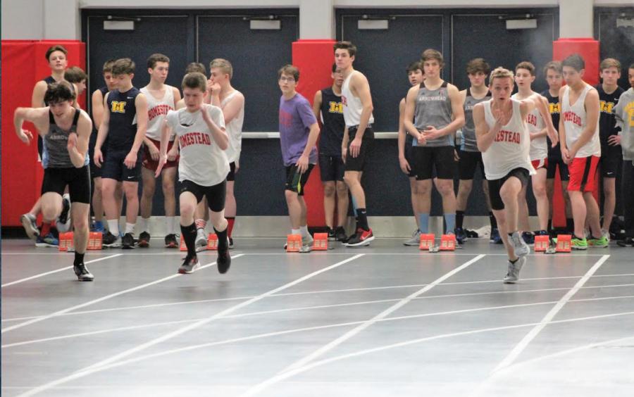 David Klein, freshman, and Ryan Boehlke, sophomore, run sprints.