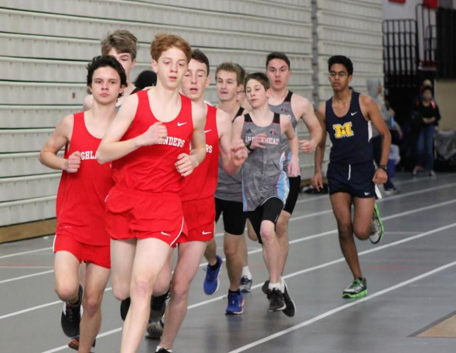 Jackson Rush, followed by Luke Starsky and Maxwell Fuehrer, freshmen, run the mile.