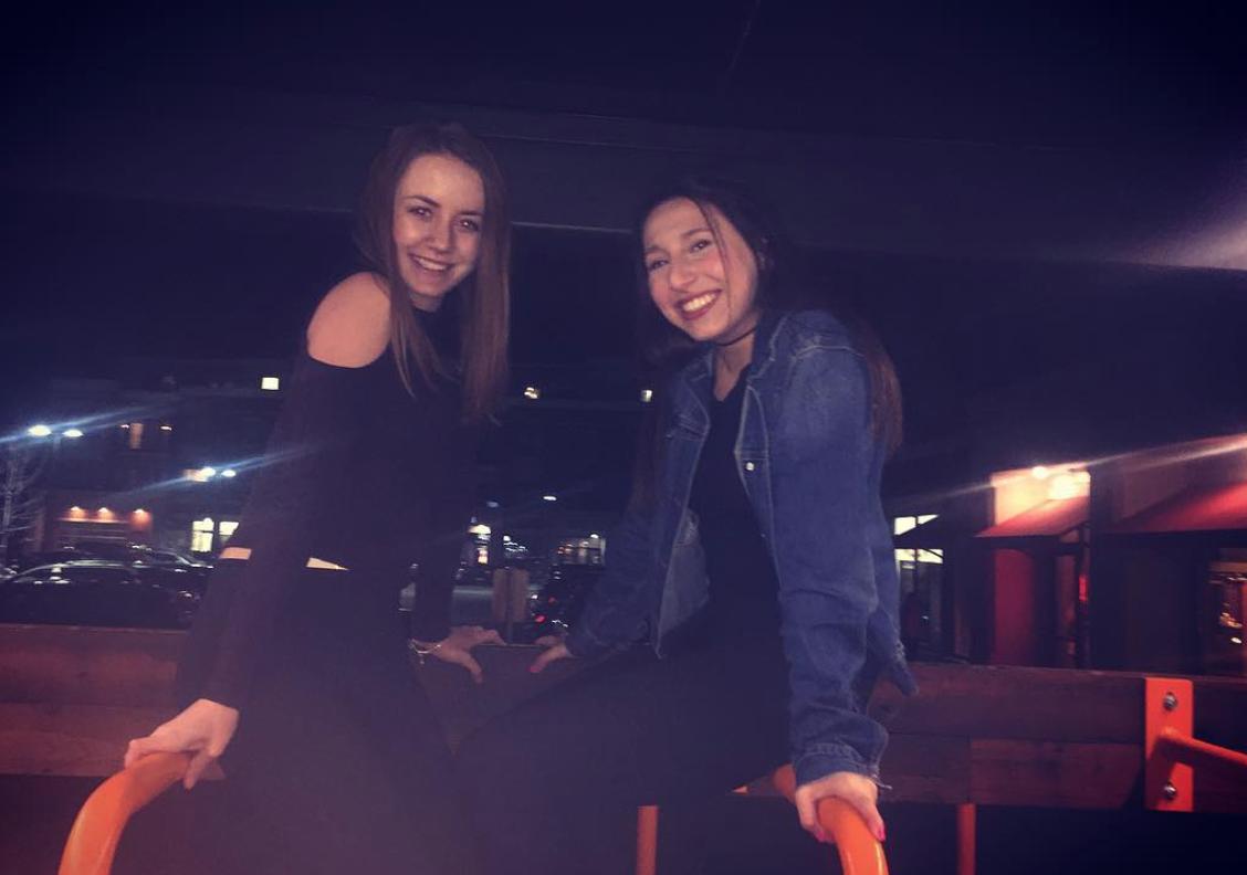 Emily Schuyler (left), freshman, poses with Ellie Bakalinsky, freshman, in front of Cafe Hollander.