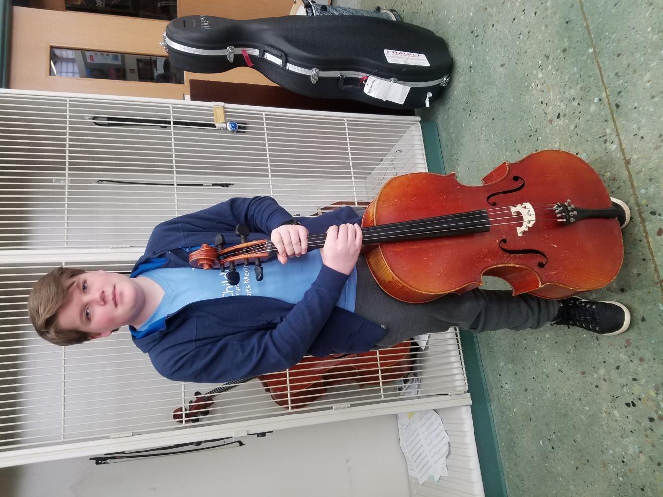 Seth Amland, freshmen, plays cello for Homestead.