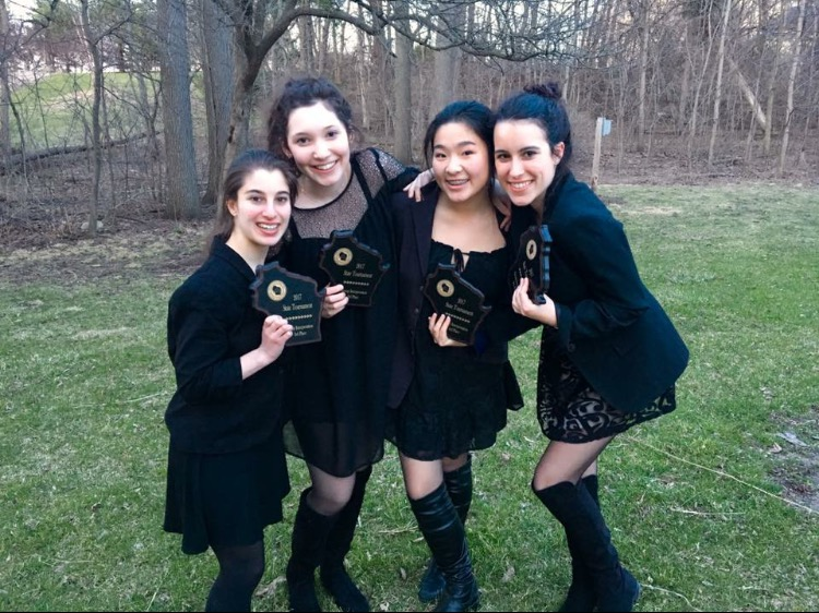 Sophia Bern, Rebecca Chavin, Tiffany Liu and Kate Gorlinski, seniors, pose with their third place trophies from state.