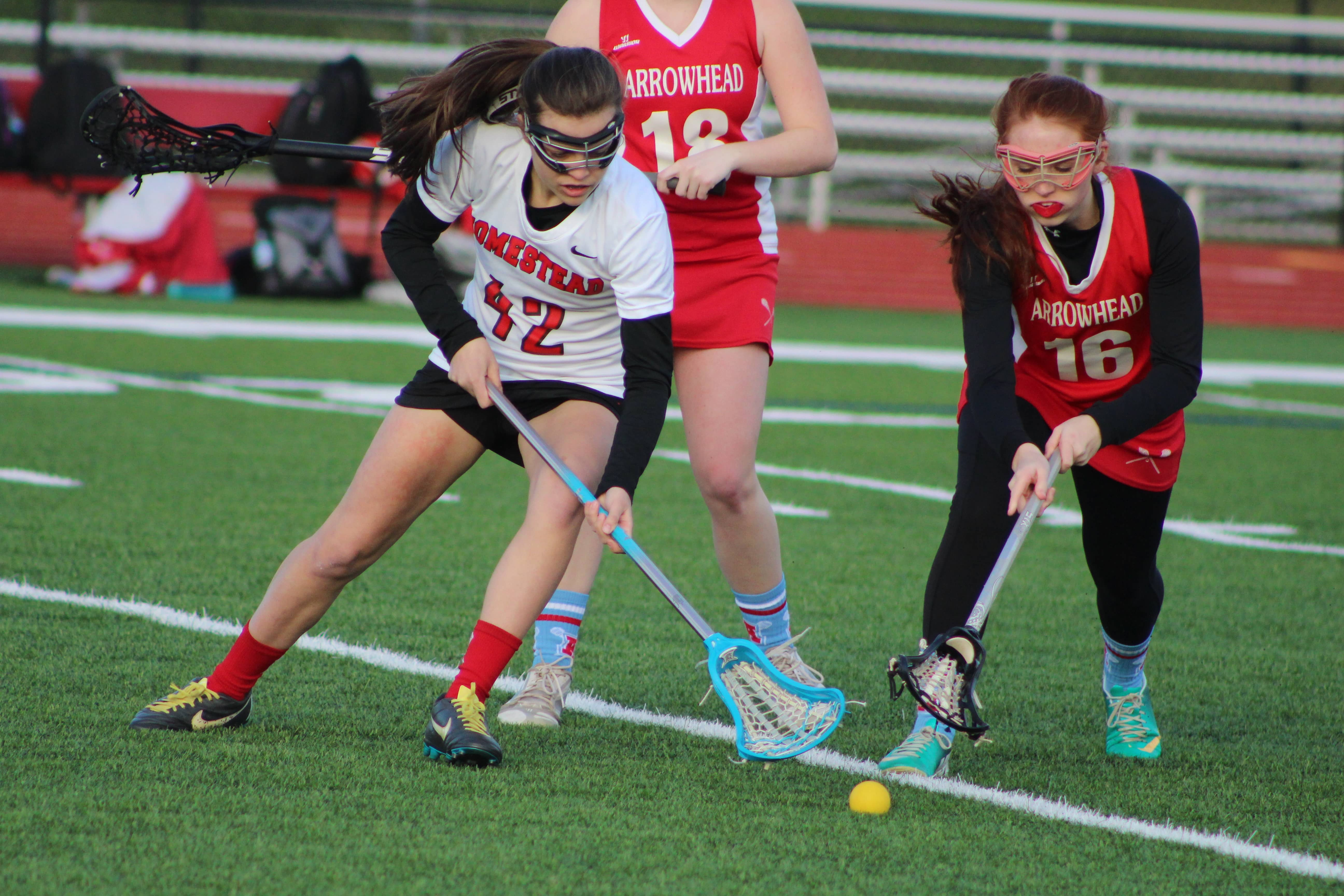 Lindsey Schimpf, sophomore, attempts to gain possession of the ball.