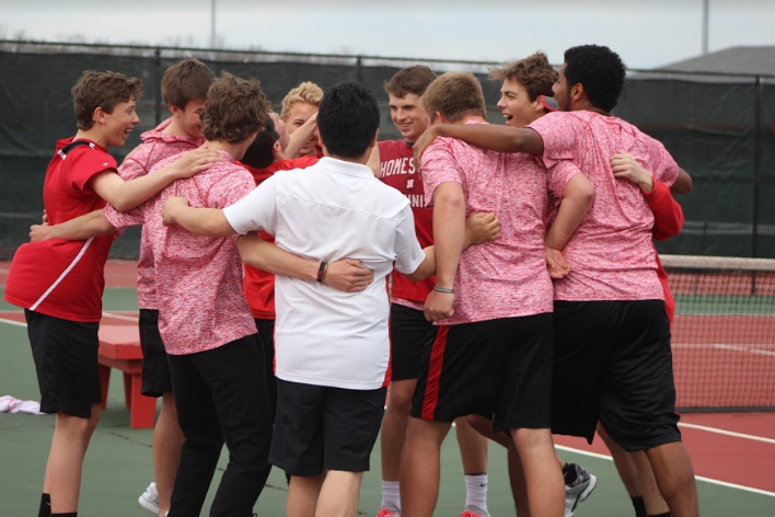 Boys+huddle+before+starting+their+matches.+